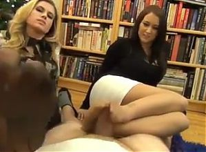 Two perverted colleagues give a great footjob.mp4