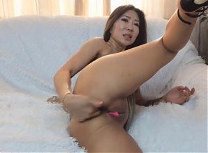 Hot Asian with great legs and heels fingers herself to XTC.