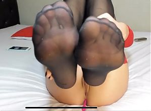 Bongamodel show her feet in stockings. Montage